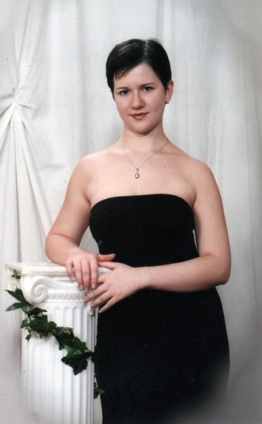 My senior-year roommate, Cat. This was her senior portrait, I believe. Year 2000.