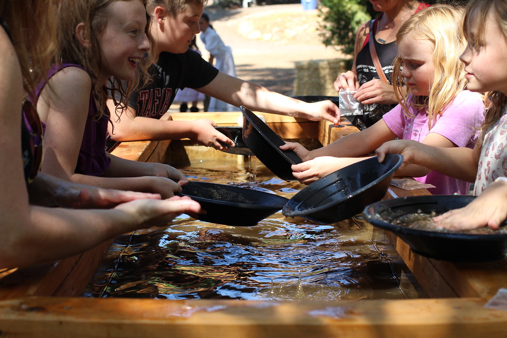 . Gold panning is always one of the most popular activities during the weekend long event. Visitors learn how to pan for gold like early Ridge prospectors did. Photo by Hannah Jones.