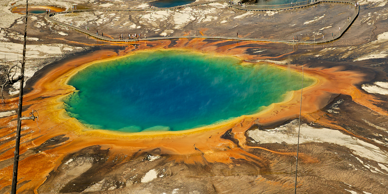 "GRAND PRISMATIC SPRING<br /> <br /> Temperature 147-188°F --- 250x380 feet.<br /> This is the largest hot spring in Yellowstone and the third largest in the world.<br /> The Famed Hayden Expedition in 1871 named this spring because of its beautiful coloration, and artist Thomas Moran made watercolor sketches depicting its rainbow-like colors. The sketches were thought to be exaggerated until geologist A.C. Peale returned in 1878 to verify them. Deep blue center, pale blue edge, green algae on the shallow edge and a scalloped rim of yellow to orange.<br /> <br /> This unique image is fused directly onto a specially treated, rigid piece of Aluminum.<br /> More archival and lighter than a framed paper print, it arrives ready to hang.<br /> The Float-Mounted MetalPrint™ needs no frame and<br /> will appear to float 3/4"" from your wall.<br /> <br /> Archival paper prints are also available<br /> ------- Contact us for more information -------<br /> moreinfo@RobertHowellPhotography.com"