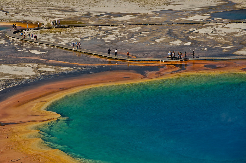 """ Prismatic Springs ""   ____ 6233Kh<br /> <br /> This is a beautiful image of the hot spring's colors and Yellowstone visitors... Is that you on the boardwalk?<br /> <br /> This unique image is fused directly onto a specially treated, rigid piece of Aluminum.<br /> More archival and lighter than a framed paper print, it arrives ready to hang.<br /> The Float-Mounted MetalPrint™ needs no frame and<br /> will appear to float 3/4"" from your wall.<br /> <br /> Archival paper prints are also available<br /> ------- Contact us for more information -------<br /> moreinfo@RobertHowellPhotography.com"