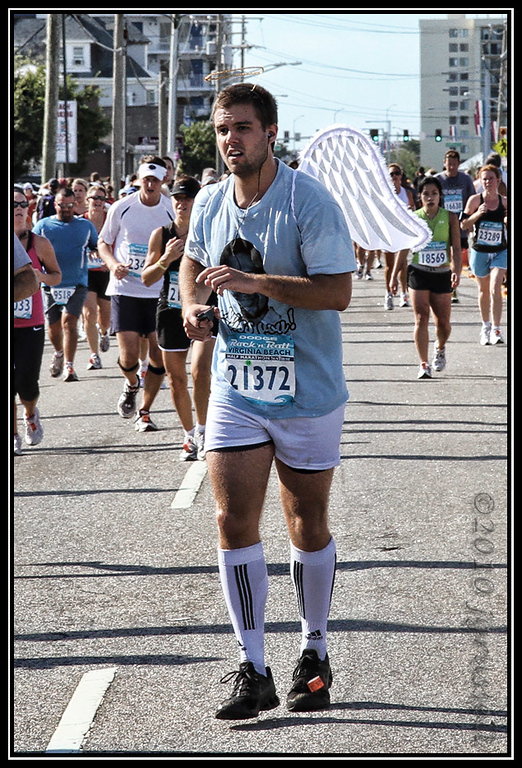 Some ran for those who will not run again. (The shirt and angel wings honored a young man who died while running the same race a year earlier.)