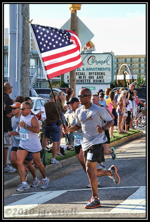 "Some ran on behalf of others. (The flag-carrier's shirt reads: ""Injured Marine Semper Fi Fund."")"