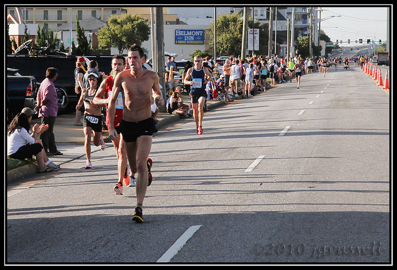 By the time I moved down the street to position myself for later, the serious runners were already heading into the last two miles.