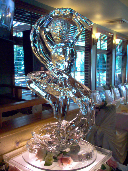 Ballerina Ice carving on rotating lighted drain tray.