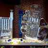 Boost Mobile Phone Ice Luge with complimenting 3-d sculpture of hand holding Boost mobile phone.