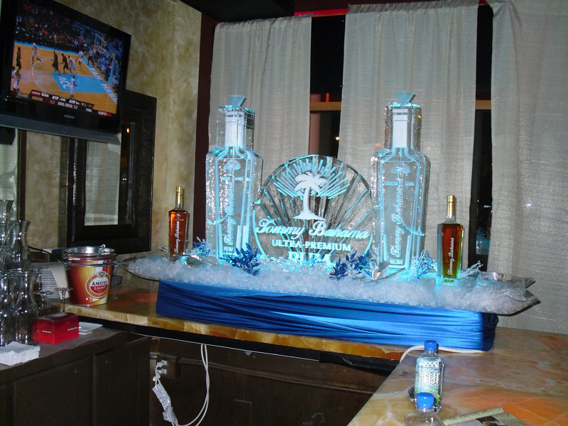 Tommy Bahama Logo with 2 bottles made into Ice Luges with Hoses and Funnels