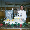 Martini Madness Ice Luge with complimenting ice bottle holder and garnish display