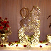 Swan over open heart ice carving