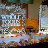 Fall leaf design with Whole Foods Market logo and the Food Bank Logo for Taste of Thanksgiving