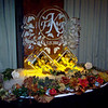 Custom Winery design ice sculpture with Monogram and wine bottle holder display