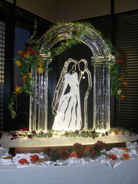 Bride and Groom under arch ice sculpture