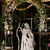 Bride and Groom under 3-d Arch Ice Sculpture with flowers