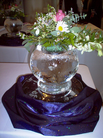 Orb centerpiece ice sculpture with flower cut out on top