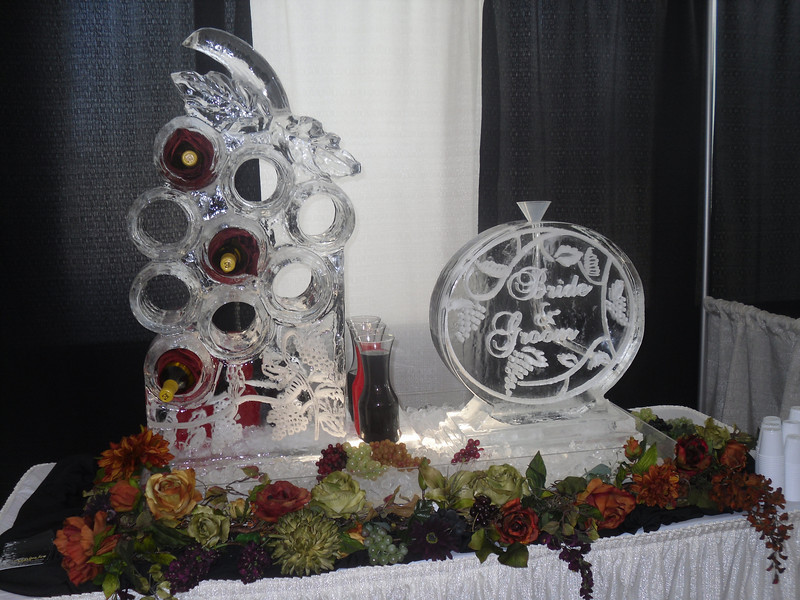 Grapes Bottle holder with Accenting Ice Sculpture luge. Display at Wedding Show