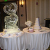 Wedding Ice Sculpture placement can be next to the cake, or anyplace you would like. We only require a sturdy table with a floor length linen (to hide the drain bucket) and an electrical outlet nearby for the light under the Ice Sculpture.