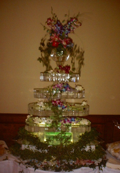 Real, working water fountain with vase on top.Water can be colored to match Wedding colors