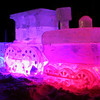 Train ice sculpture lit with LED lights at night in Loveland Colorado