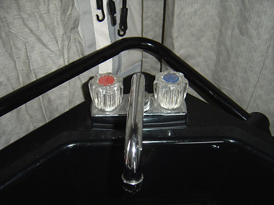 Turn on the hot water faucet which will allow the water heater to fill up with dilute bleach water.