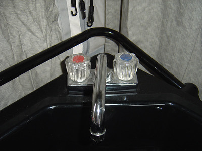 Turn on both the hot and cold water faucets and flush out the dilute bleach solution.  Repeat the same for the shower.
