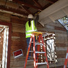 Beth Ann Reeves removes underside of front porch