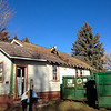 Beau Beitscher removes shingles. Jenn Coffee installs t-posts.