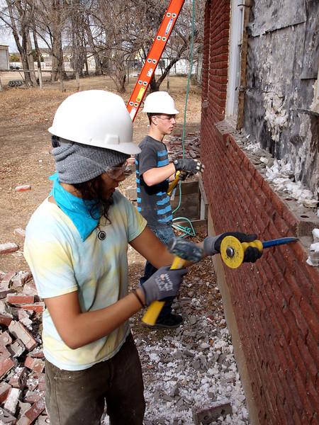 Tai and Damon remove bricks