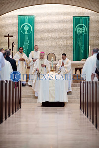 Auxiliary Bishop Greg Kelly incenses the casket carrying Deacon David Obergfell at the end of the Mass of Christian Burial August 3 at St. Pius X Catholic Church.