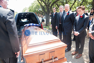 The casket of Deacon David Obergfell is carried out to the hearst after the Mass of Christian Burial August 3 at St. Pius X Catholic Church.