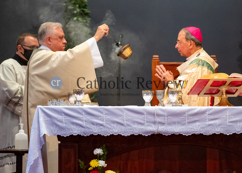 Deacon Scott Kady blesses Archbishop William E. Lori with incense during his ordination to the diaconate August 8, 2020 at St. Ignatius Church in Hickory. (Kevin J. Parks/CR Staff)