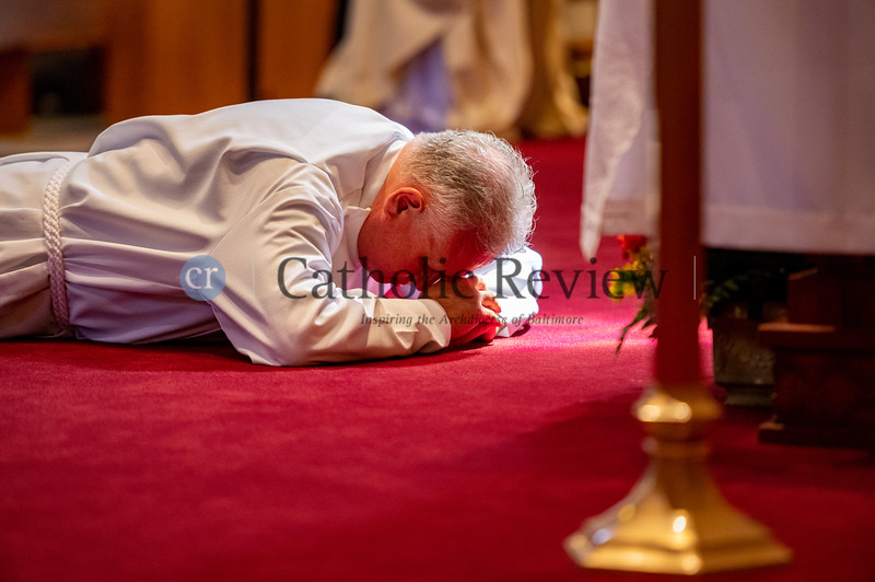 Seminarian Scott Kady prostrates in front of the altar at St. Ignatius Church in Hickory prior to his ordination to the diaconate August 8, 2020. (Kevin J.Parks/CR Staff)