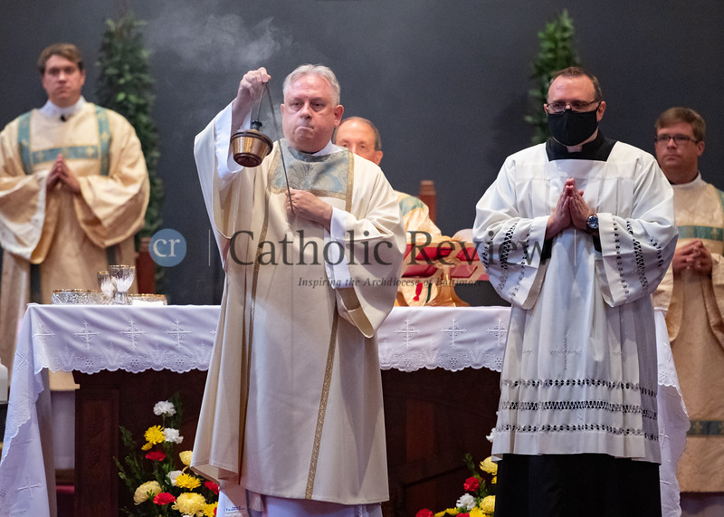 Deacon Scott Kady blesses parishioners with incense during his ordination to the deaconate August 8, 2020 at St. Ignatius Church in Hickory. (Kevin J. Parks/CR Staff)