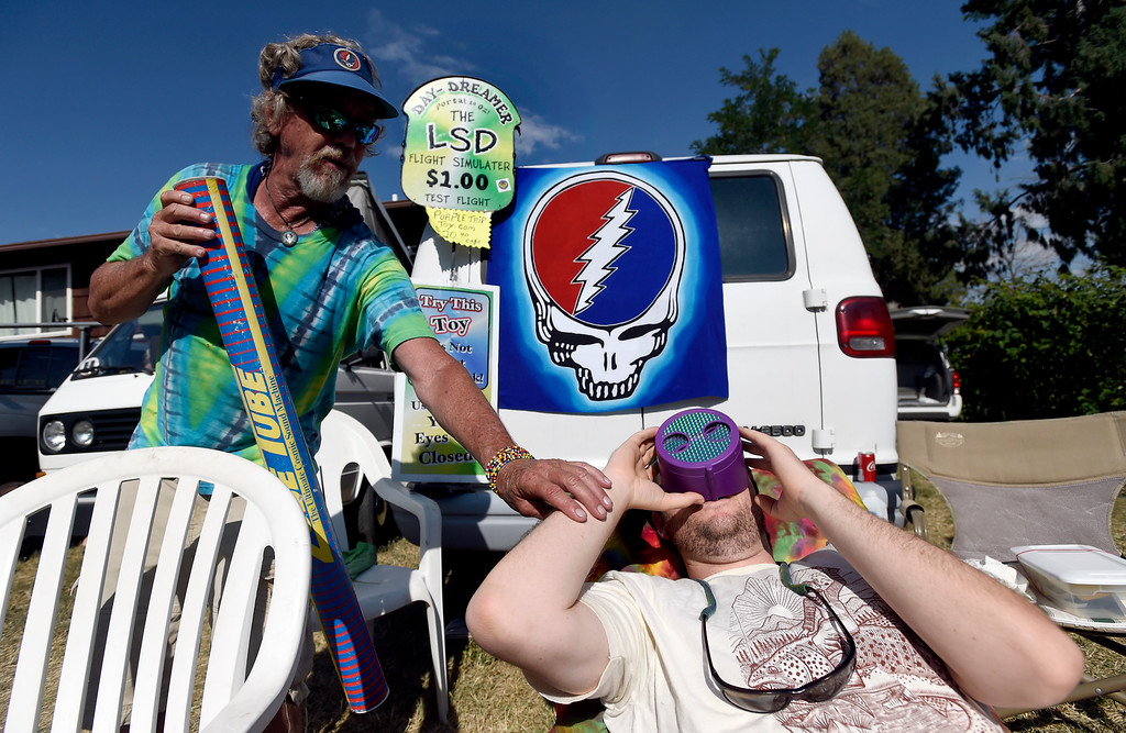 . Kelly Green, of Loveland, at right, tries the Day-Dreamer Portal to Oz LSD Flight Simulator under the supervision of Tom Gray, at left, before the start of the Dead & Company concert on Friday at Folsom Field on the University of Colorado campus in Boulder. For more photos of the event go to dailycamera.com Jeremy Papasso/ Staff Photographer 07/13/2018