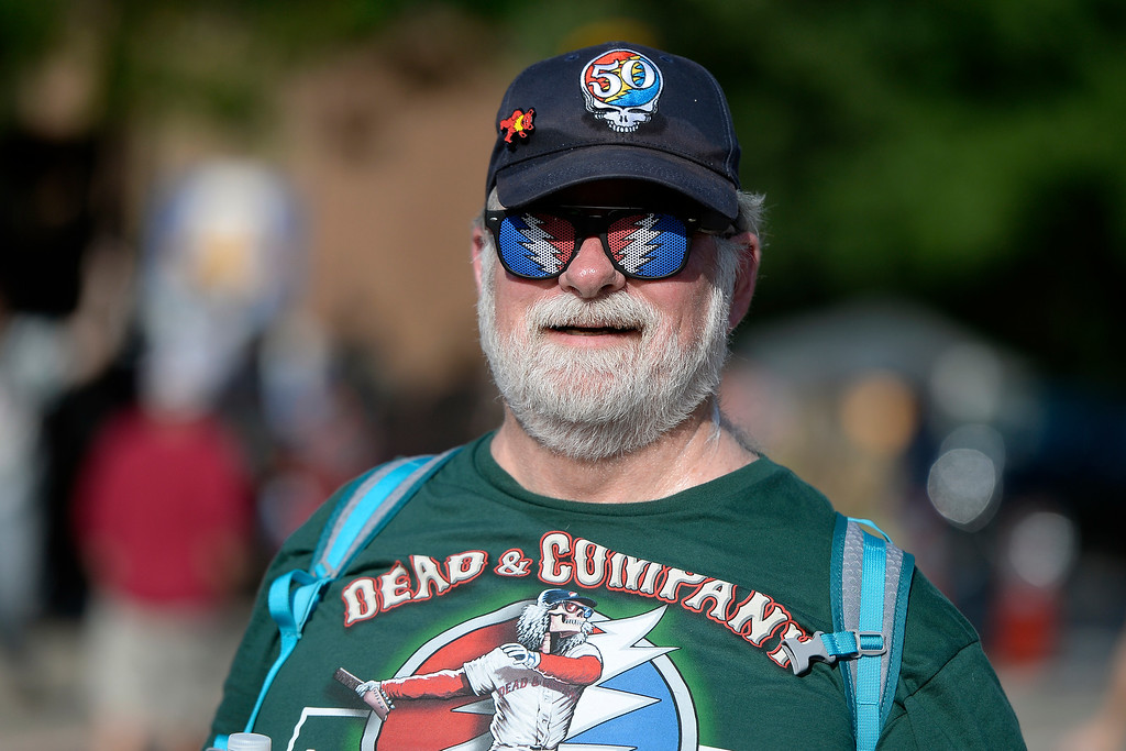 . Todd Pfeifer, of Pittsburg, walks towards the line decked out in Greatful Dead gear before the start of the Dead & Company concert on Friday at Folsom Field on the University of Colorado campus in Boulder. For more photos of the event go to dailycamera.com Jeremy Papasso/ Staff Photographer 07/13/2018