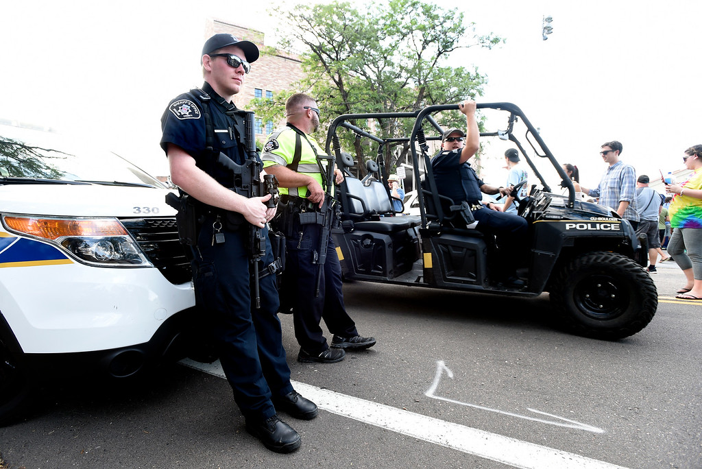 . Boulder County Sheriff\'s Deputies McKinley, left, and George stand gaurd near the line to enter the Dead & Company concert on Friday at Folsom Field on the University of Colorado campus in Boulder. For more photos of the event go to dailycamera.com Jeremy Papasso/ Staff Photographer 07/13/2018