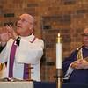 Fr. Ken signing the Eucharistic prayer