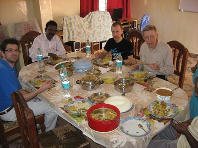Pastor Jeff Jordan (left in blue shirt) and Pastor Alfred Griffith (on right) having a delicious meal while visiting the deaf school in 2012.  Dennis Sand in the black shirt accompanied the pastors at the school - as a photographer