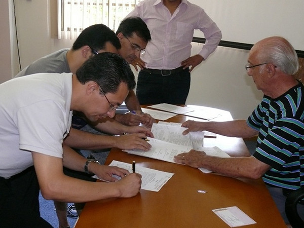 Here members of the Deaf group also sign the legal organizing papers for the new official branch of Gospel Outreach.  One of the first Gospel Outreach projects in Brazil is to be one involving ministry to Deaf.