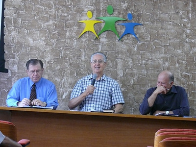 Discussions about the mechanics of officially organizing a Gospel Outreach branch office in Brazil.  Leo Ranzolin chairs the meeting.  He was originally from Brazil, but is retired from the General Conference of SDA and currently lives in Florida.