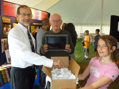 Dr. Keith Leavitt who drew the winning name for the Acer tablet Pastor Blake is holding.  The young lady is wishing very much that it might be her name - but unfortunately it was not her name!