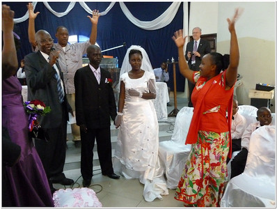 Pastor Paul Muasya, President of the East Africa Union Conference of SDA, has just married this deaf couple in Mombasa, Kenya, in Feb./12.    Raising the waving hands is a typical method of approval in the deaf world, instead of clapping.