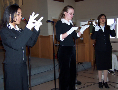 Three deaf members signing a song for the Harmony SDA church in Toronto, Canada