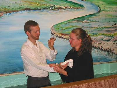 Pastor Paul Kelly, from New York State, has been coming up monthly to minister to deaf at the Harmony Adventist church in Toronto, Canada.  Shown here is the baptism by immersion of Farrah Gooding who is the Deaf Ministry leader of the Harmony Adventist Church. See their web site at: http://www.harmonysdachurch.org/deaf/