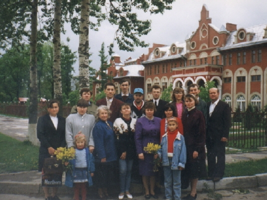 Deaf group standing together outside SDA Seminary in Russia where Vasily trained
