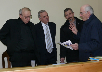(L to Right)  Pastor Blake explaining details of deaf ministry in Canada and other countries to the Western Ukraine Adventist Conference leadership in Dec./07.  This Conference has just recently hired Pastor Vasily Yagotin to head deaf ministry in the Lvov area.