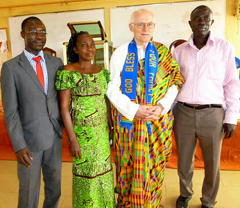 (Left to Right) Gospel Outreach [GO] worker, Harrison Antwi, his mother; Pastor John Blake, Director of the Deaf Ministry Department at Gospel Outreach; and Harrison's father whose business is as a buyer of cocoa.  Harrison is the first GO worker in Ghana.  In the picture, Blake has just been given the gift of a lovely Ghana traditional costume- possibly hand woven.