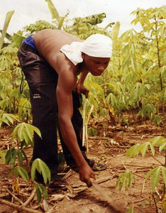 Abudu attends deaf school and shown here working in a garden