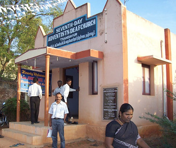 As far as we know, this is the first Seventh-day Adventist church in the world ever built just for deaf - at Thanjavur in South Inda.  The first pastor, Sathiyamoorthy, is standing by the front step, and the present pastor, Manikaraj, has his hand on the wall by the door.