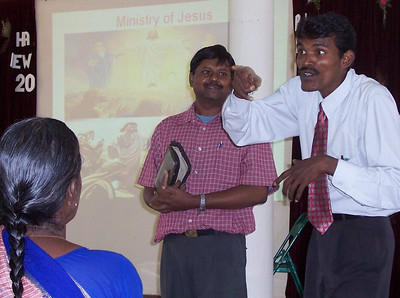 Pastor Manikaraj, interpreting Dr. Rao's talk for the Deaf group on the Ministry of Jesus at Thanjavur in South India.  There are three people working with the deaf in this area.