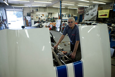 Dean Jeffries in his shop with some of his cars in the background.