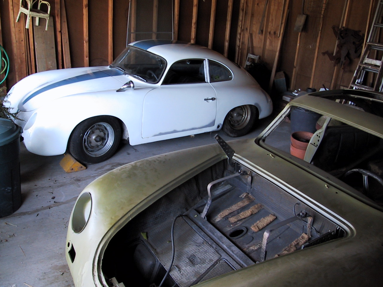 This shot was taken shortly before the second restoration started. The car in the foreground is a 1956 Sunroof Coupe 356 with a serial number 641 cars later than the Carrera. It was sold to help finance the restoration.